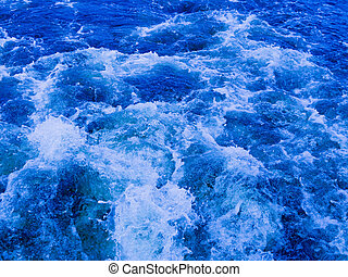 blue water boils and flows - Blue water flowing bubbling and...