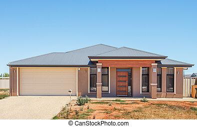 Modern Suburban House - typical facade of a new suburban...