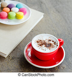 Cup of hot coffee and macaroons - Cup of hot coffee and...