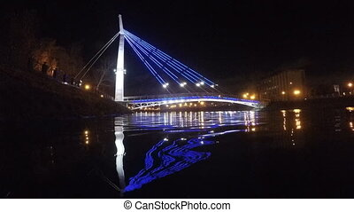 Bridge with lights reflected in the water at night