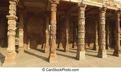 Pillars at the Qutb Minar complex - - Sandstone pillars at...