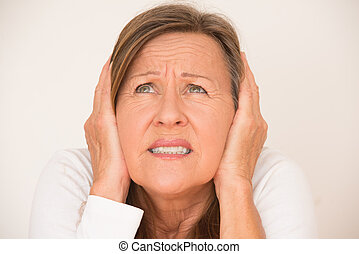 Scared anxious woman covering ears