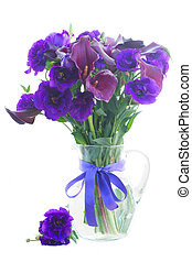 Calla lilly and eustoma flowers in glass vase isolated on...