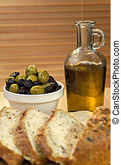 Olive Oil, Stuffed Green and Black Olives and Rustic Bread