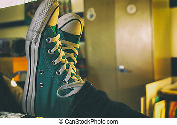 Tennis shoes on table - Photograph of a pair of tennis shoes...