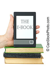 Hand put e-book reader on top of classic paper books...