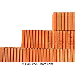 Building a brick wall. Bricklaying work.