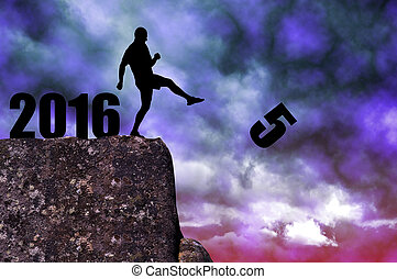 Concept New Year 2016 - Silhouette of man kicked to fives on...
