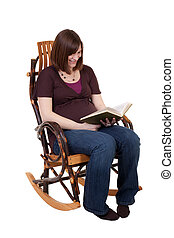 Pregnant Lady Reading - a pregnant mother sitting in a...
