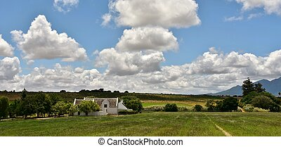 Farm House - Landscape with Farm House and clouds in the sky