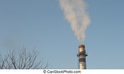 Smoke coming out of industrial brick chimney