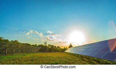Solar panels and sun, panoramic time-lapse