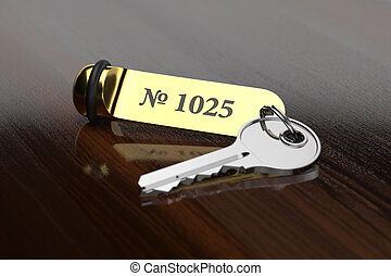 Hotel room key with golden lable