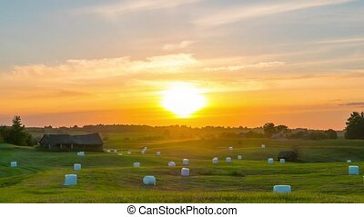 Sunset over the field, time-lapse - Sunset over the field,...