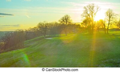 Sunset in the spring park, panoramic time-lapse