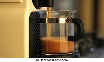 Coffeemaker brewing espresso coffee - Single-serving coffee...
