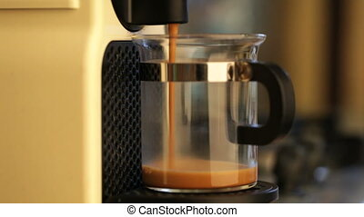 Coffeemaker brewing espresso coffee