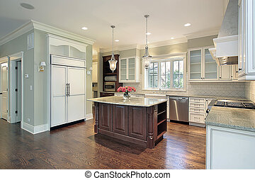 Kitchen with granite island - Kitchen in luxury home with...