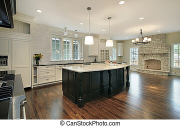 Kitchen and family room with stone fireplace