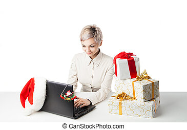 lady at desk with present boxes and hat over white - Pretty...