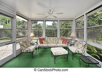 Porch with green flooring - Porch in suburban home with...