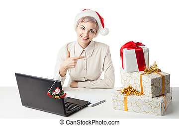 lady in winter hat at desk with present boxes - Pretty young...