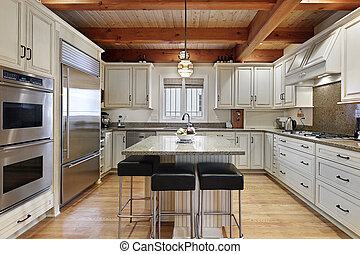 Kitchen with wood ceiling beams - Kitchen in luxury home...