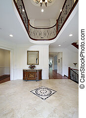 Foyer with floor design - Foyer in luxury home with floor...