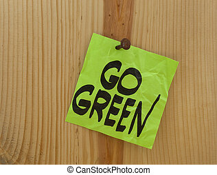 go green concept - go green reminder - green crumpled sticky...