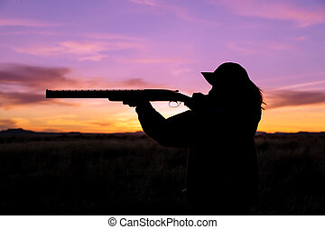Hunter Silhouetted at Sunset