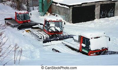 View of ratrak tractor machines at ski resort