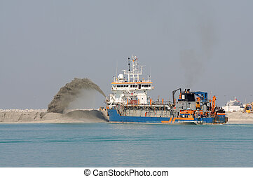 Special dredge ship pushing sand to create new land in...