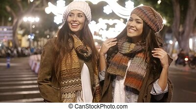 Two young women enjoying a night on the town - Two young...