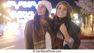 Two vivacious young women laughing and having fun - Two...