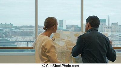 Business People Discussing Area Development Plan - Two...