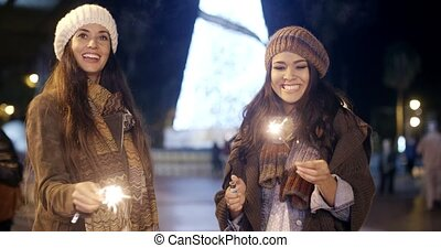 Attractive young women having fun at Christmas standing...