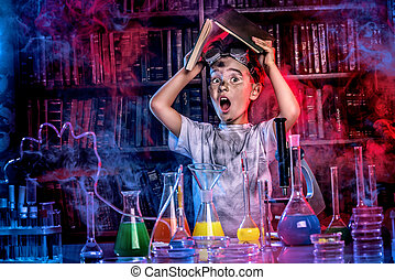 crazy study - A boy doing experiments in the laboratory...