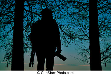Silhouette of a photographer at sun