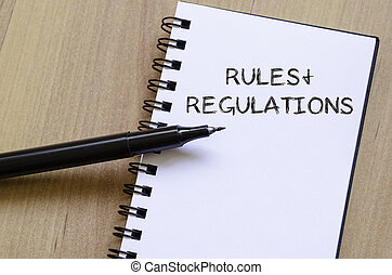 Rules and regulations write on notebook - Rules and...