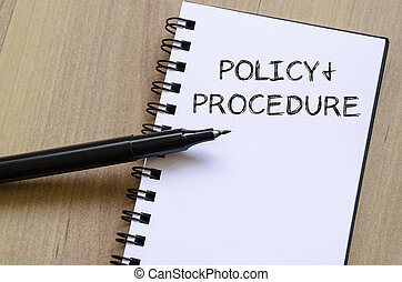 Policy and procedure write on notebook - Policy and...
