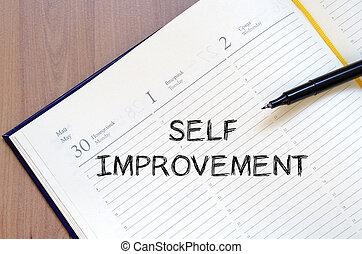 Self improvement write on notebook - Self improvement text...