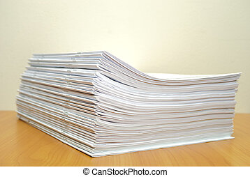 Stack of white journals in office desktop Shallow deep of...