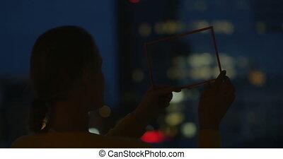 Woman Holding Transparent Tablet