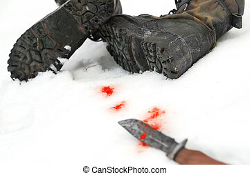 Knife And Boots - Crime scene, camouflage boots on the snow...