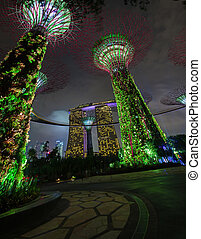 Bold Green Lights from the Towers of Gardens by the Bay in...