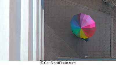 Pedestrian Twists Colored Umbrella - Overhead shot of the...