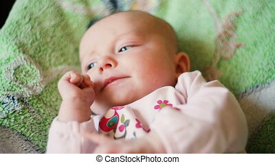 Cute newborn baby laying in the bed