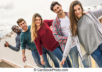 Group of friends having fun together outdoors - Group of...