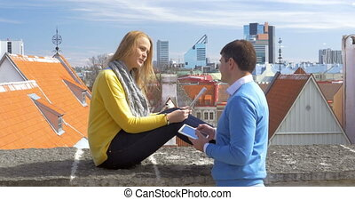 Tourists on the Roof in Tallinn - Two tourists with map and...