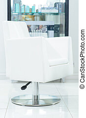Hairdressers chair is ready to serve its customers -...